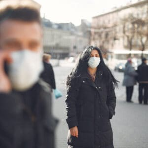 Pedestrians wearing masks to prevent COVID-19 transmission.